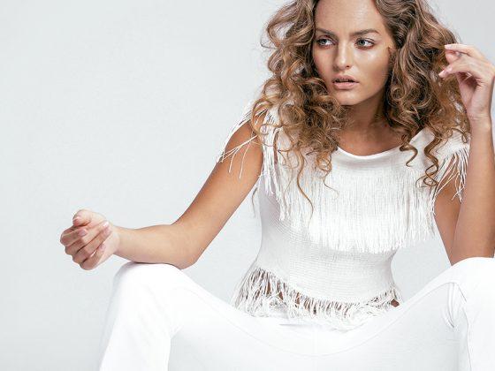 Jonathan Simkhai Fringe Top, $565, Atrium Miami. L'agence Blanc Elysee Flare Jeans, $245, Atrium Miami.