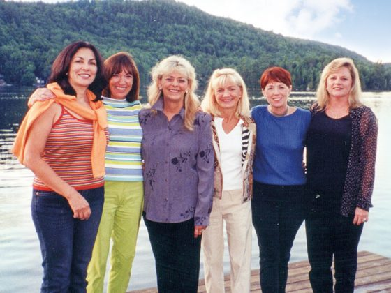 Chris Turner, Anne Woods, Judi Macy, Suzanne Schaffer, Lyn Pechuls & Donna Brigham meet in the Adirondack Mountains in July 2001. This trip was the beginning of the journey in authoring The Mothers' Club.