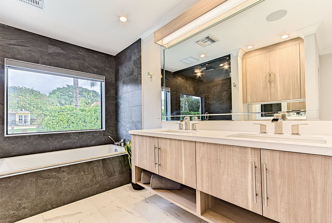 Features marble flooring, rainforest showerhead and his and hers sinks.