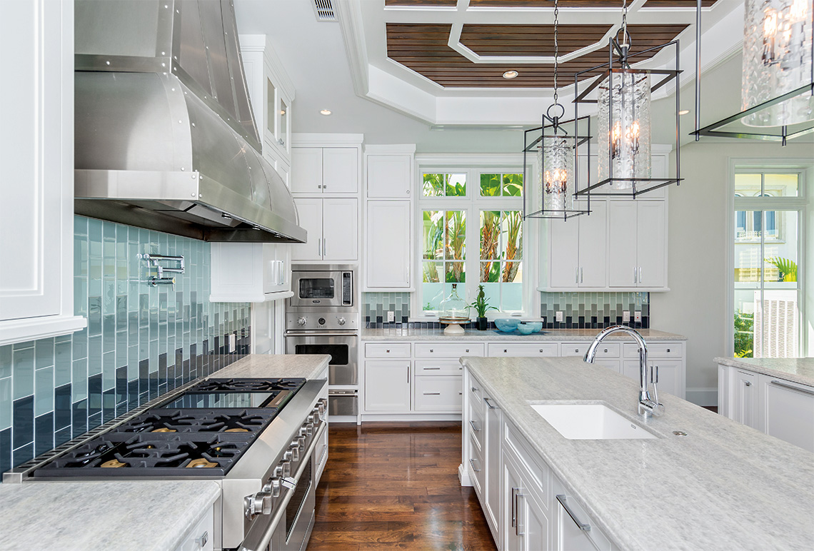 Crushed ice granite counter tops with leather finish throughout the kitchen. Twin double door Sub-Zero refrigerator, Viking pro series gas stove, custom commercial pro series ventilation hood, Viking pro series convection oven, twin Bosch dishwashers.
