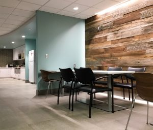 Random width reclaimed barnwood paneling used in an office break room.