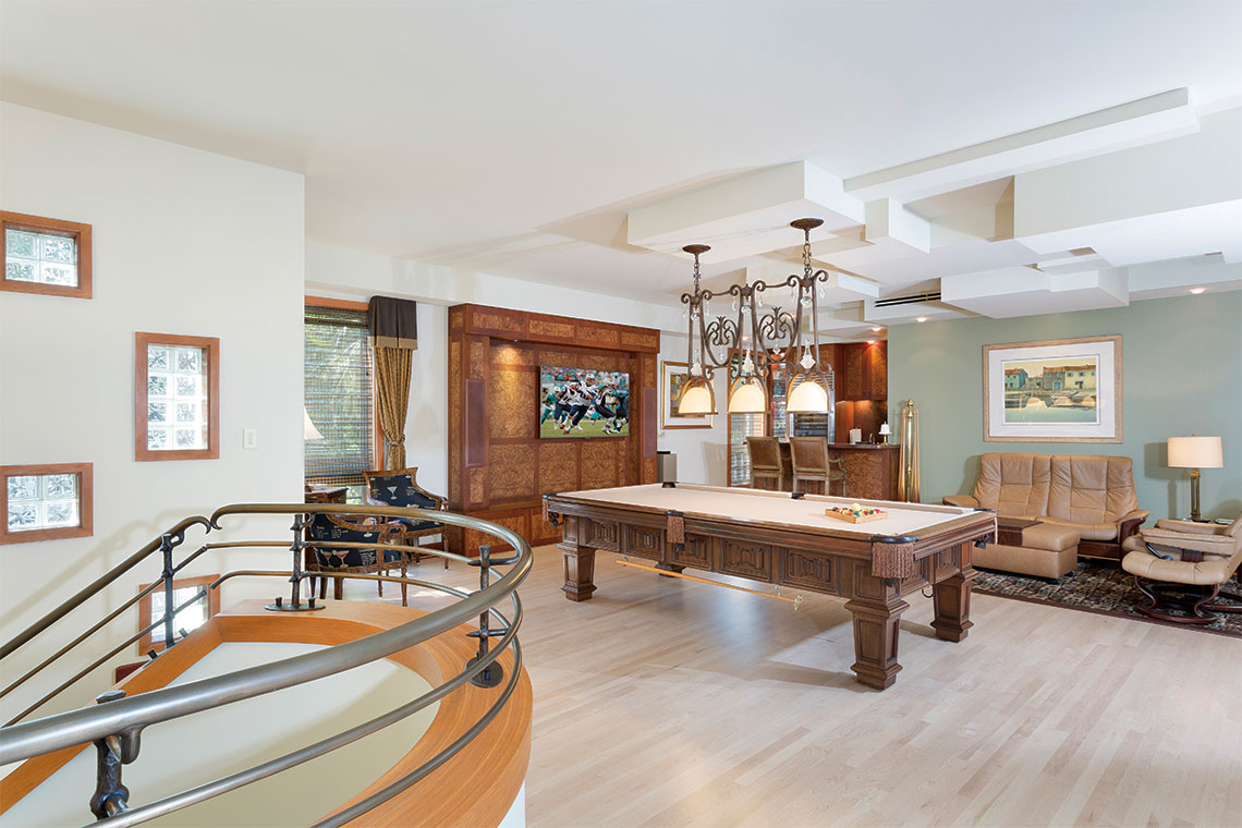 The entertainment area includes a pool table and full-service wet bar featuring a refrigerator, dishwasher and wine cooler. Photography: Ed Butera, IBI Designs.