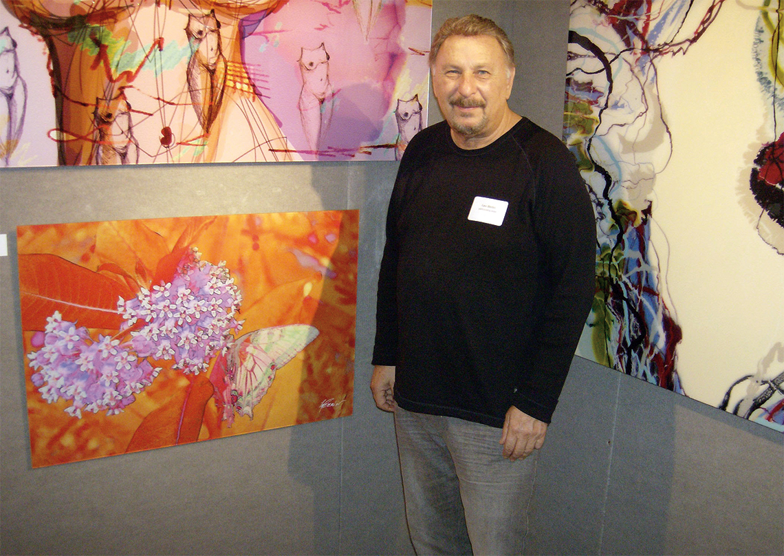 ArtServe artist-in-residence and participating artist Lee Berlin with his work.