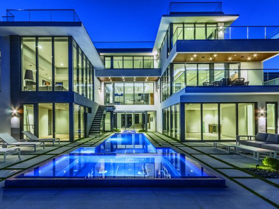 The home is solid concrete and steel construction. The pool is 50×15 and six feet deep with electrical heater and spa. Photography: Myro Rosky Photography.
