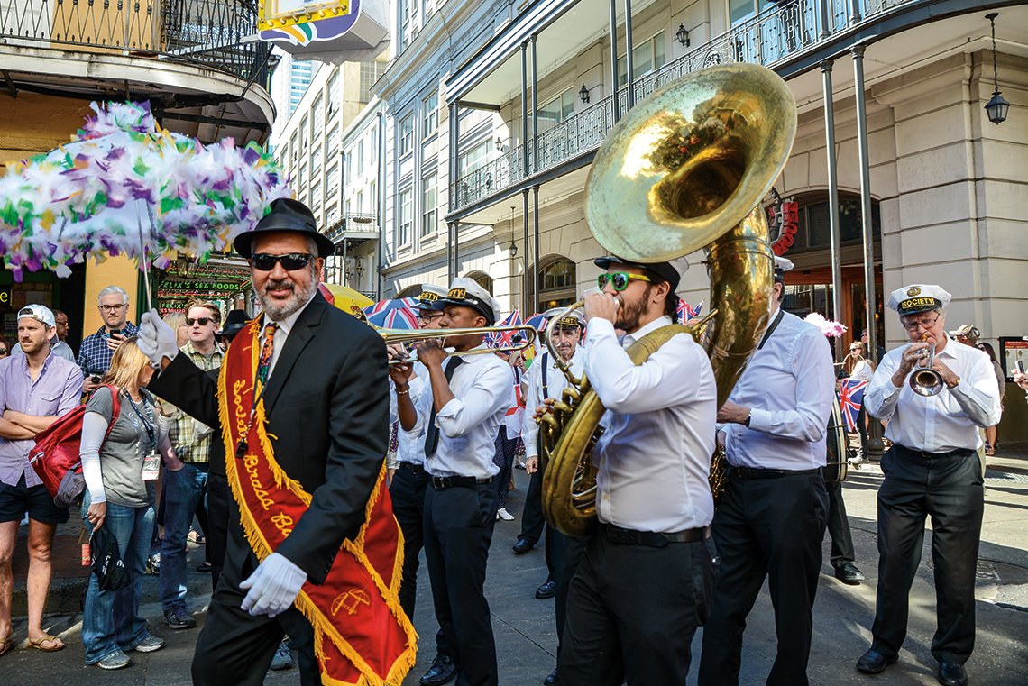 A band plays in the French Quarter for French Quarter Fest. Photography: Shutterstock / Siouxsnapp.