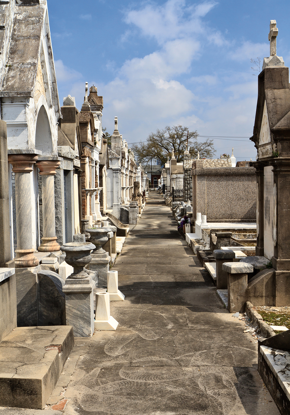 A row of marble and granite above-ground tombs in Lafayette Cemetery. Photography: Shutterstock / Colin D. Young.