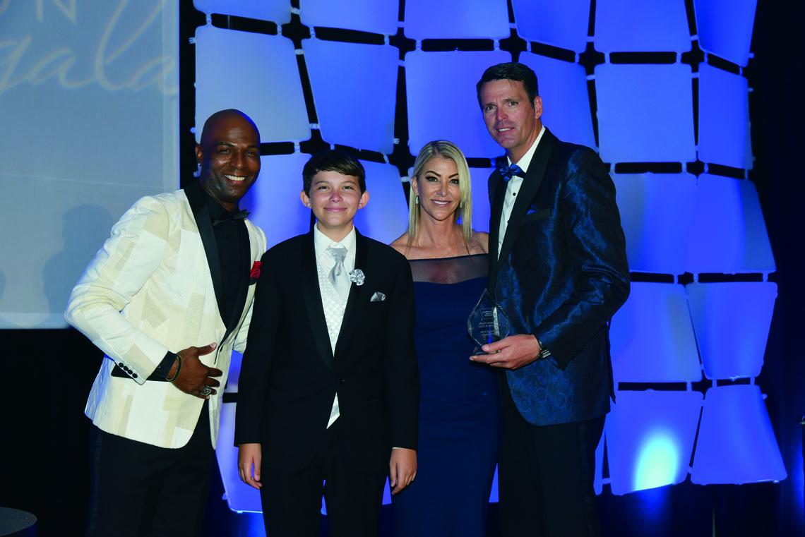 Dale McLean, 2018 gala emcee; Chase Sweers; Kim and Randy Sweers, honoree family.