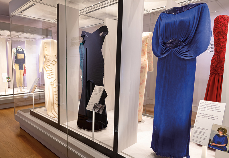 "Exhibits from ""Diana: Her Fashion Story,"" including the dress she wore at the White House when she danced with John Travolta (right, center). Photography: Historic Royal Palaces."