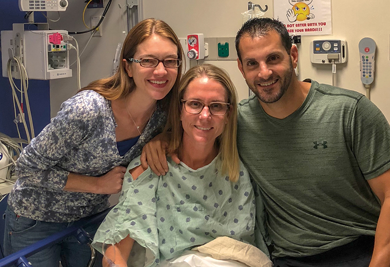 Lisa Emmott, left, with Allison Malouf and Allison's husband Jason.