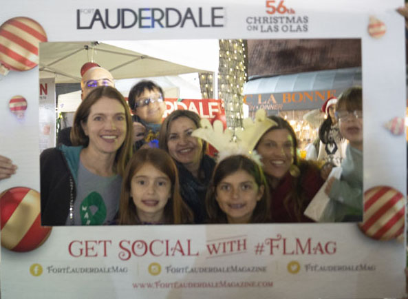 Christmas On Las Olas While Mingling With Locals As They Eed Freebies And Our Photo Booth People Stopping By Also Entered For A Chance To Win Two