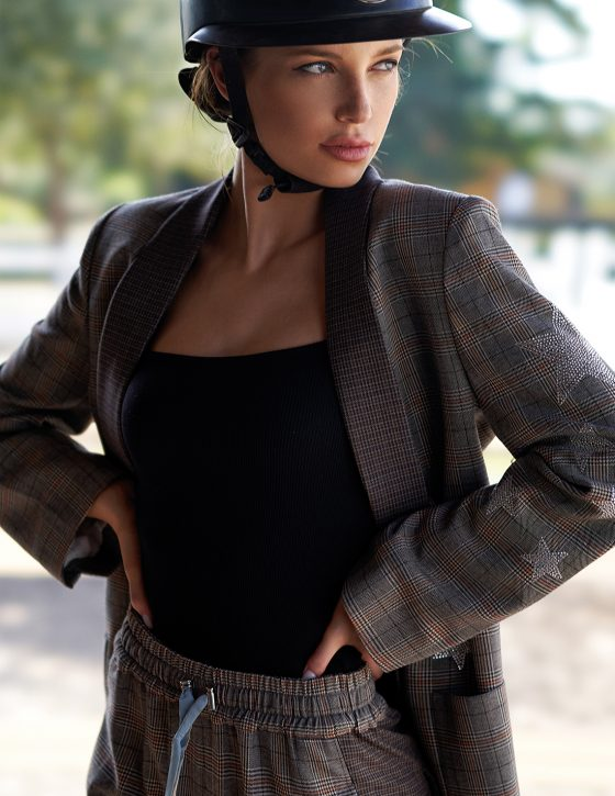 Tweed Jacket by Zadig and Voltaire, $648, available at Bloomingdale's, Aventura. Tweed Pants by Zadig and Voltaire, $298, available at Bloomingdale's, Aventura. Black Bodysuit by Zara, $19.90, available at Zara.