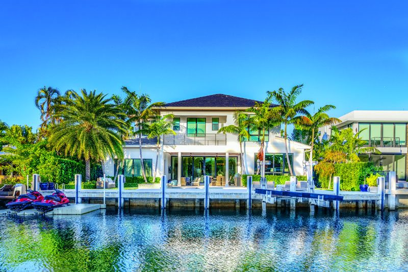 The waterfront property features a private dock and a canal width of 81 to 120 feet. Photography Courtesy of Todd Kirkpatrick, Whitaker Realty.